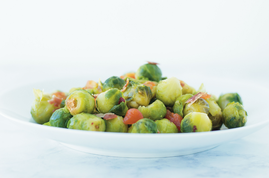 This Brussel Sprouts recipe is a quick and easy 20 minute side dish that is healthy and delicious. Only a few simple ingredients will jazz up up these sauteed brussel sprouts. Plus, who doesn't love bacon? It is a paleo, keto, and gluten free side dish your whole family will love! #sauteed #healthy #keto #brusselsprouts #maplebacon