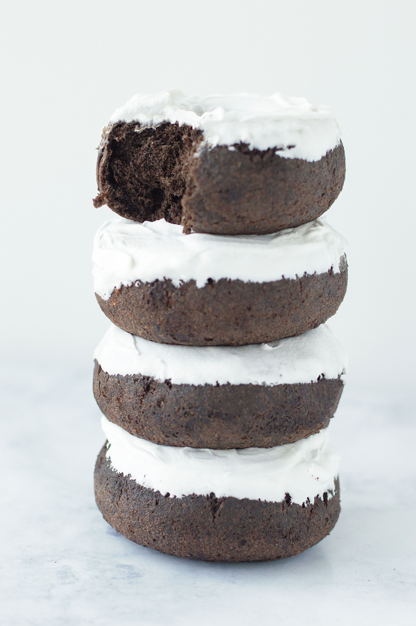These low carb protein donuts are a healthy alternative to your local Krispy Kreme. They are an easy, high protein treat. While these donuts are keto and paleo friendly they are made with simple ingredients. This recipe is gluten free and dairy free while being totally delicious! Try it with your favorite chocolate protein powder! #lowcarb #ketodonuts #proteindonuts #glutenfree